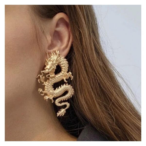big gold dragon earring on ear of a nidek